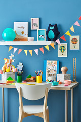 Beautiful modern kid's desk with decorations.