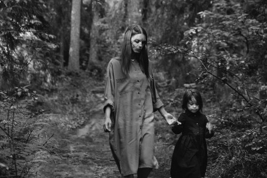 Little girl and mother in the forest