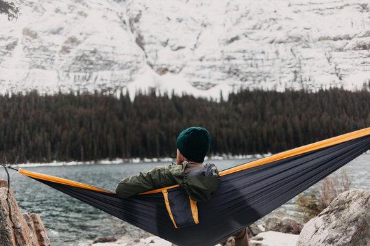 Man Relaxing in Hammock in Outdoorsy Winter Landscape
