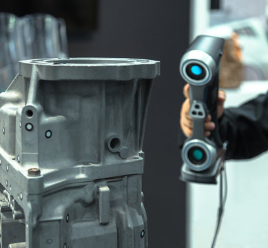 Engineer scans the part with 3D scanner. Technology scanning