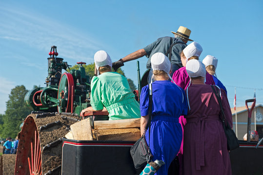 Amish Ladies with Dad on Steam Engine