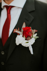 Colorful corsage on the lapel of a suit jacket