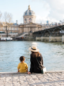 Mom and baby sitting at Seine River