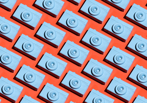 Blue film cameras pattern on dark peachy colorful background