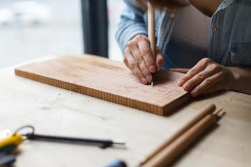 Female carpenter working in studio