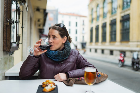 Young woman drinking a spanish wine on the street