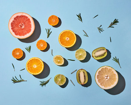 Juicy composition of sliced citrus on blue background