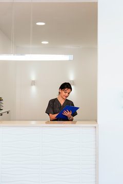 Receptionist working in the reception of dental clinic.