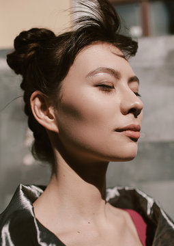 Portrait of beautiful Asian woman with eyes closed