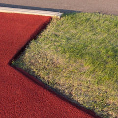 Close up of sports field, grass and painted asphalt