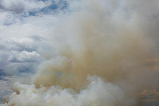 Billowing smoke and clouds from controlled farmland burn, Saskatchewan, Canada