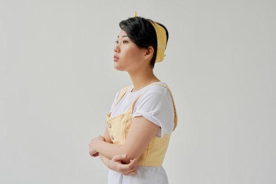 Studio portrait of Asian woman against white background