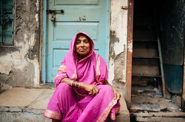 Portrait of woman sitting in front of door