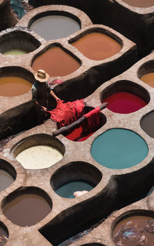 Man dyeing skins in Chouara Tannery, Fes, Morocco