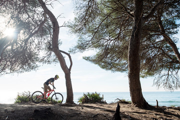 Mountain biker riding in front of the sea