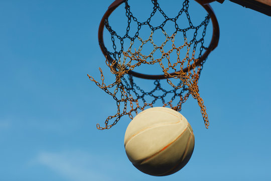 Low angle view of basketball falling from basketball hoop