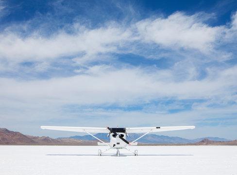 Single engine airplane parked on Bonneville Salt Flats, Utah