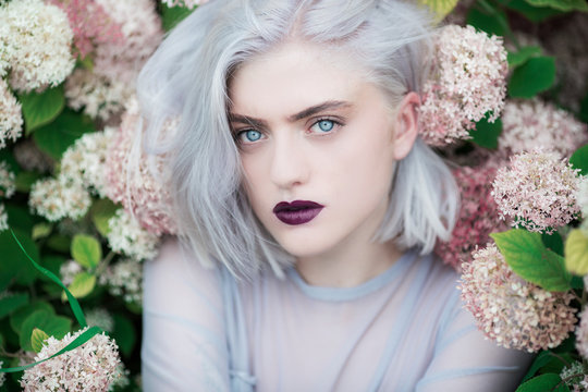Portrait of a beautiful young woman in flowers