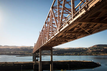 A bridge from a train along the Columbia River Gorge in Oregon.