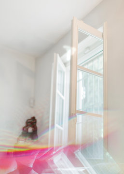 Multicolored light leaks over an open window inside white room