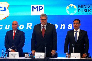 Attorney General Chinchilla of Honduras, U.S. Attorney General Barr and El Salvador's Attorney General Melara pose for a picture during a news conference, after a meeting of Attorney Generals of Northern Triangle of Central America in San Salvador