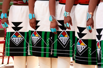 Zuni women wearing traditional regalia and turquoise jewelry