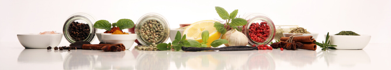 Spices and herbs on table. Food and cuisine ingredients with basil Fototapete