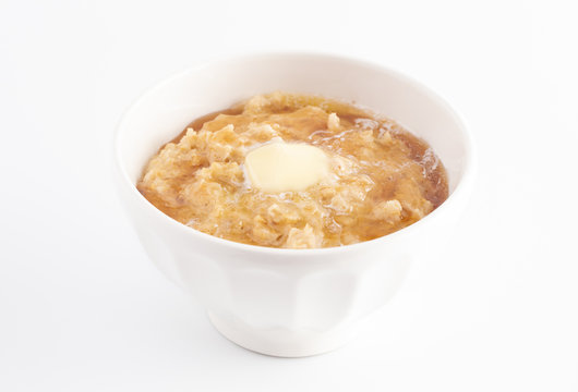Oatmeal with Butter and Honey on a White Background