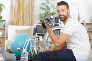 man in a wheelchair is doing sports