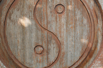 Yin-Yang symbol carved on wooden door