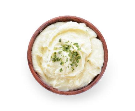 Bowl with tasty mashed potato on white background