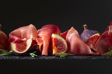 Fototapete - Figs with prosciutto and rosemary.