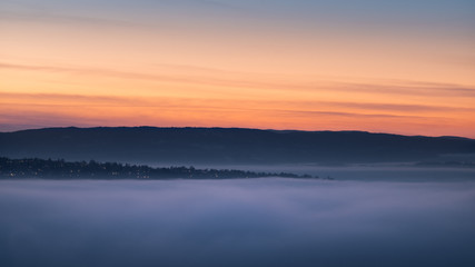 Dreamy fog over landscape in sunset