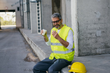 worker having lunch break on construction site