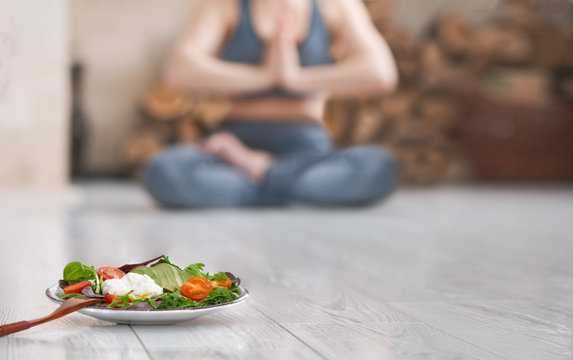 Young woman do yoga. Healthy food after a workout.