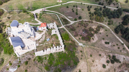 Aerial view of Rabsztyn Castle ruins on hill top in sunny day, Poland