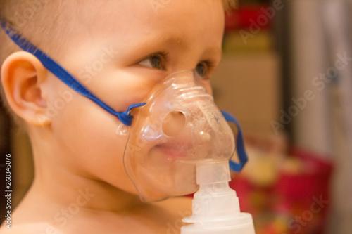 Blurred photo  Child asthma inhaler inhalation nebulizer steam sick