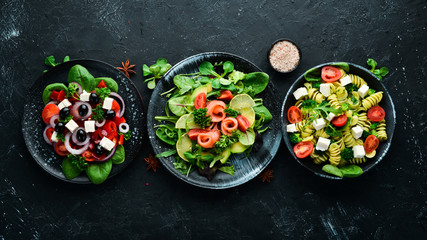 Assortment of food. Folk cuisine on a black wooden background Top view. Free space for your text. Flat lay Fototapete