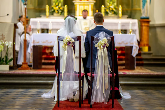 Bride and groom during wedding ceremony in church.