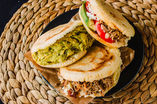 Arepas venezolanas is a traditional dish from Venezuela and Colombia, on a rustic background