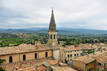 View of church and houses in St Saturnin les Apt, France