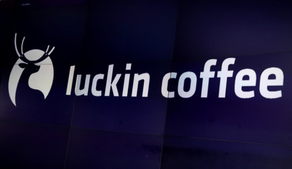 A screen displays the logo for Luckin Coffee during the company's IPO at the Nasdaq Market site in New York