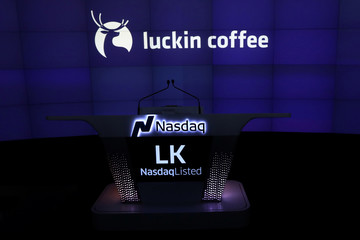 A screen displays the logo and trading symbol for Luckin Coffee during the company's IPO at the Nasdaq Market site New York