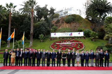 Ministers Responsible for Trade (MRT) of APEC, wave to the media as they pose for a family picture during a meeting ahead of November Presidential summit in Vina del Mar