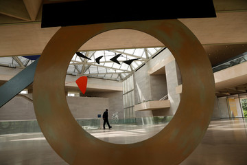 A guard walks the atrium of the East Building of the National Gallery of Art designed by renowned architect I.M. Pei, in Washington