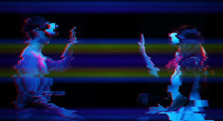 Couple of people communicate using a virtual reality headset. Image with glitch effect.