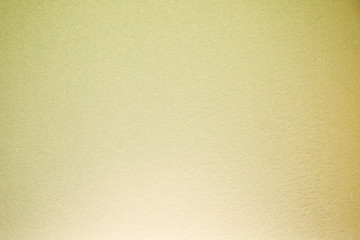 Fully blurred textural background of cream and yellow
