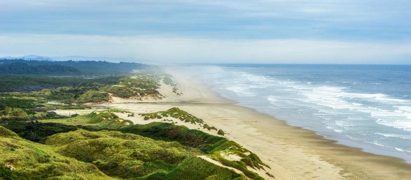 Oregon coast sand dunes overlooking panorama. OR, USA.