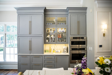 Gray Grey modern Kitchen cabinets in a large expensive kitchen