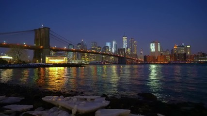 Wall Mural - Panoramic view of Brooklyn bridge and Manhattan at sunrise, New York City.